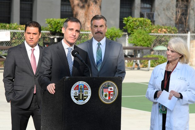 From left: City Councilman Jose Huizar, Mayor Eric Garcetti, Chief Charlie Beck and Dr. Astrid Heger join the Los Angeles Sheriff's Department, the Los Angeles Police Department, LAC+USC staff, the Violence Intervention Program (VIP), East LA Women's Center, and a number of other community-based organizations as they celebrated the opening of the new Family Justice Center housed at the LAC+USC Medical Center. Los Angeles, CA 1/011/2018 (Photo by John McCoy, Los Angeles Daily News/SCNG)