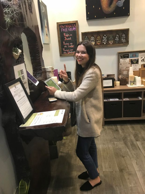 Dominique Koudsi was the first customer at The Higher Path cannabis shop in Sherman Oaks to buy adult-use marijuana, just moments after the shop received notice they were granted state approval. (Photo courtesy of Jerred Kiloh, owner of The Higher Path)