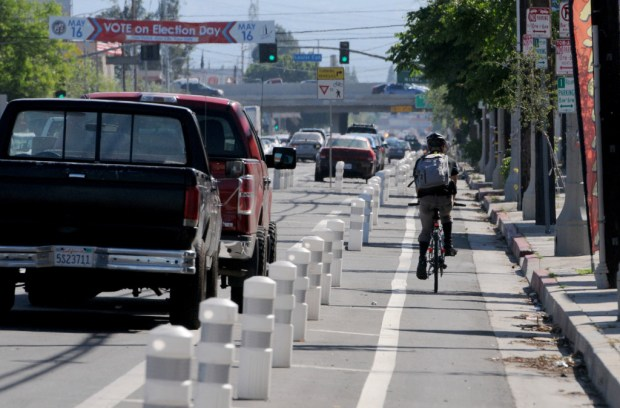 A bicycle rider travels down Van Nuys Boulevard between Laurel Canyon Boulevard and San Fernando Road in Pacoima. The traffic and bicycle lanes were created from the Vision Zero program. (File photo by Dean Musgrove, Los Angeles daily News/SCNG)