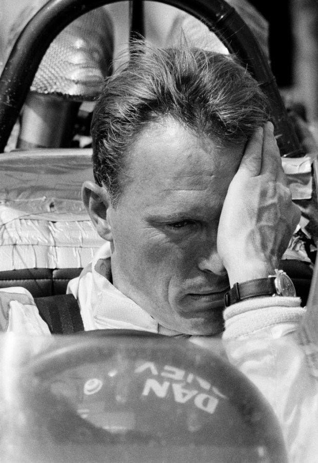 FILE - This May 31, 1969 file photo shows Grand Prix racer Dan Gurney. Gurney, the first driver to win in Formula One, IndyCar and NASCAR, died Sunday, Jan. 14, 2018 from complications of pneumonia. He was 86. His wife, Evi, announced his death in a statement distributed by All American Racers, Inc. (AP Photo)