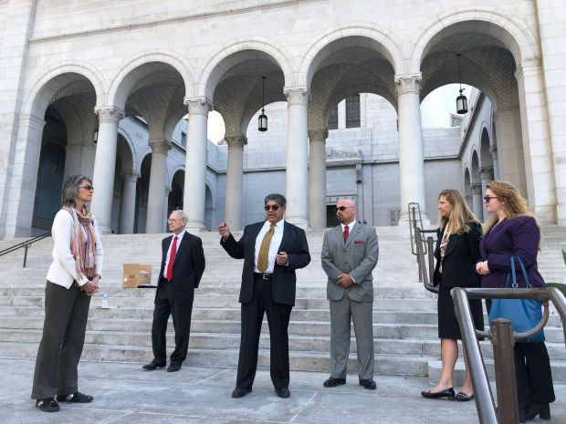 David Hernandez, third from left, is one of the proponents of a referendum effort to get rid of a newly launched city trash hauling program, announces the start of petition gathering during a City Hall news conference Thursday, Jan. 18, 2018. (Photo by Elizabeth Chou, Los Angeles Daily News/SCNG)