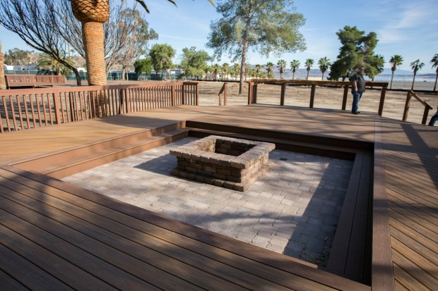 A deck wraps around a brick fire pit outside one of six new yurts at Lake Elslinore's La Laguna Resort and Boat Launch. Photo by Andrew Foulk, contributing photographer