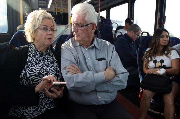 Corona City Councilman and Riverside Transit Agency board member Dick Haley, right, is joined by his wife, Christine, as they ride a bus to Disneyland on Sunday, January 14, 2018. Several RTA officials and civic leaders rode the bus Sunday, the route's first day in service. (Photo by Micah Escamilla for SCNG)