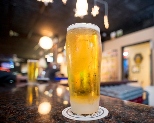 3.99 Pizza Company also serves up a draft beer at their Citrus Avenue location in Covina, Calif. Jan. 4, 2017. They will be celebrating 25 years of serving the San Gabriel Valley by offering large cheese pizzas, at the original price of $3.99-- all four restaurants will be honoring this price Thursday, Feb.1, 2018. (Photo by Leo Jarzomb, SGV Tribune/ SCNG)