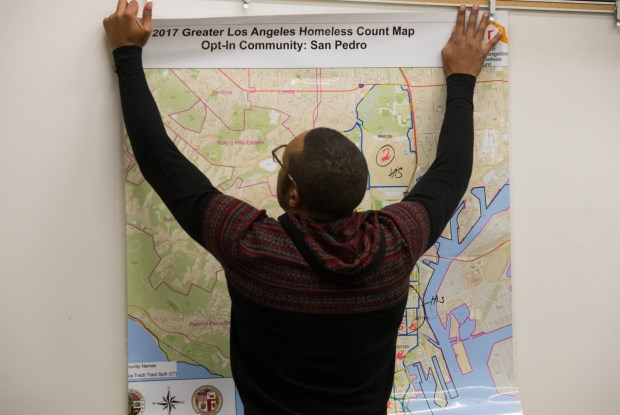 Alexander Hall places a map of San Pedro up on a wall as volunteers gathered for the annual homeless count in San Pedro Wednesday, January 24, 2018. (Photo by Thomas R. Cordova Daily Breeze/SCNG)