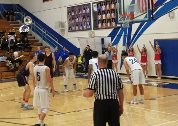 Tesoro's Kaden Garrett prepares to shoot a free throw at end of Friday's game against El Toro. Garrett made the shot and helped secure the Titans' victory. (Photo by David Delgado, Correspondent)