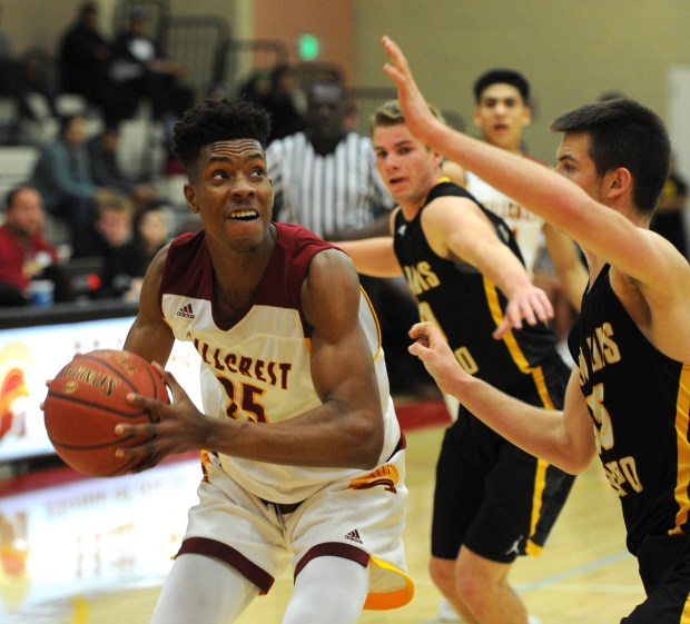 Hillcrest's Victor Ohia Obioha looks for room to attack the basket against San Luis Obispo's Carson Leedom in a Division 4AA boys basketball semifinal game in Riverside on Friday February 23, 2018.