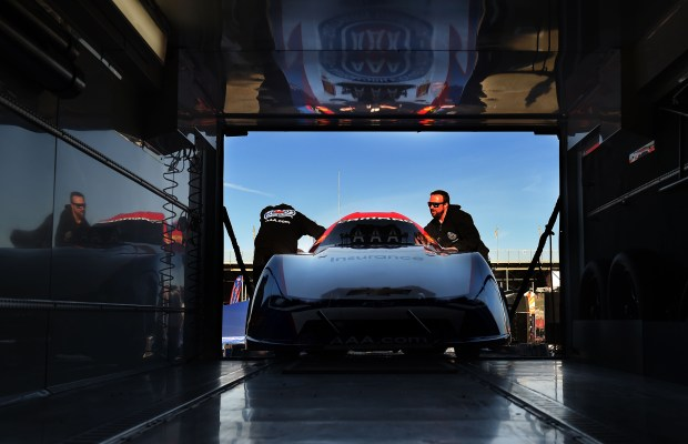 Crew members for defending 2-time NHRA Funny Car champion Robert Hight pull his 11,000hp hot rod out of the team hauler on the opening day of the 2018 season at the 58th annual NHRA Winternationals Friday morning February 9, 2018 in Pomona, Calif. (Photo by Will Lester-Inland Valley Daily Bulletin/SCNG)