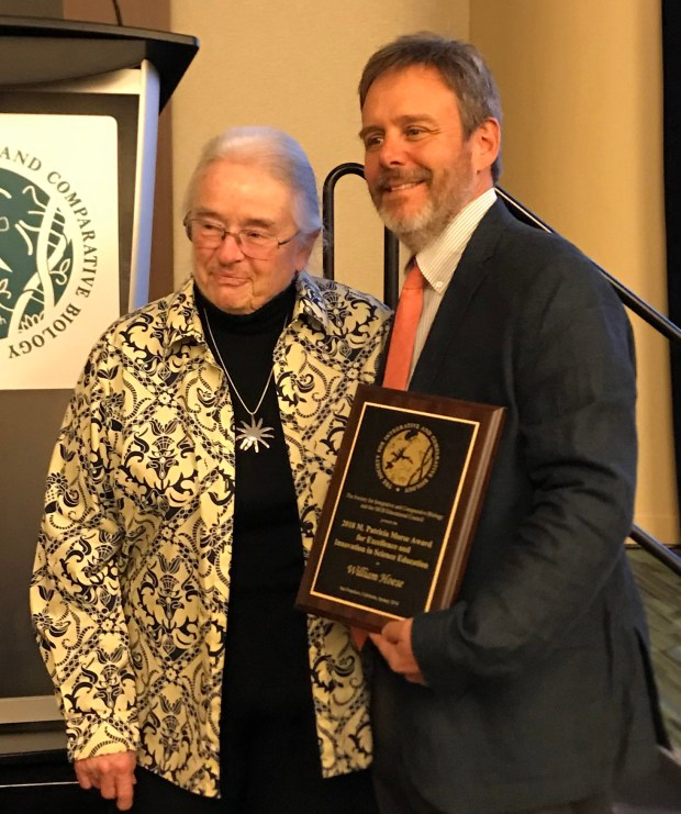 """Cal State Fullerton biology professor Bill Hoese receives the Society for Integrative and Comparative Biology """"excellence and innovation"""" in science education award from Trish Morse, for whom the award is named. (Photo courtesy of Cal State Fullerton)"""