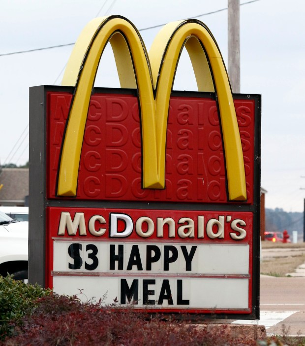 A $3 Happy Meal is advertised at a Brandon, Miss., McDonald's Restaurant, Wednesday, Feb. 14, 2018. McDonald's will undergo some changes as the cheeseburger choice and chocolate milk will be removed from the menu panels in stores, but the fast-food company says not listing the items will cut down on orders, as they make an effort to get kids to eat less calories, sodium, saturated fat and sugar at its restaurants. Parents will still be able to ask for a cheeseburger with the kid's meal, (AP Photo/Rogelio V. Solis)