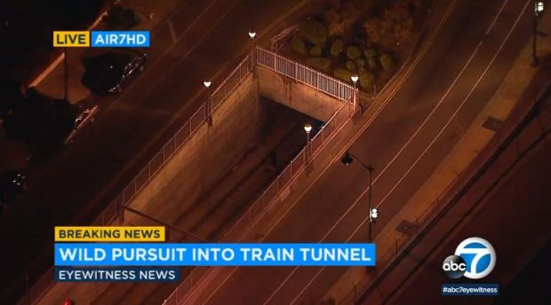 A male driver was arrested but a female passenger remains at large early Wednesday, Feb. 21, 2018, the morning after a chase of a stolen pickup in which the vehicle descended into a Metro Gold Line train tunnel in the Boyle Heights area. (Image from ABC7 video)