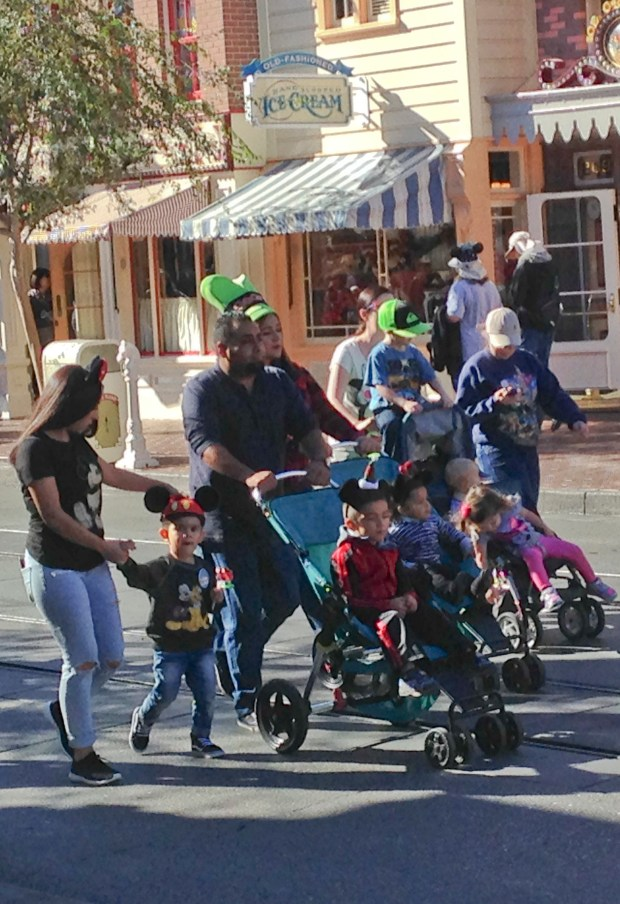 Dodging strollers at Disneyland is virtually an Olympic sport. (File photo by Mark Eades, Orange County Register/SCNG)/ ADDITIONAL INFORMATION: Reporter and photographer Mark Eades of The Orange County Register spent an entire day and night at Disneyland sitting on the front porch on Main Street USA watching the activities and visiting with park guests. Date of photo: 11/17/15. - disney.frontporch - Photo by MARK EADES, STAFF PHOTOGRAPHER