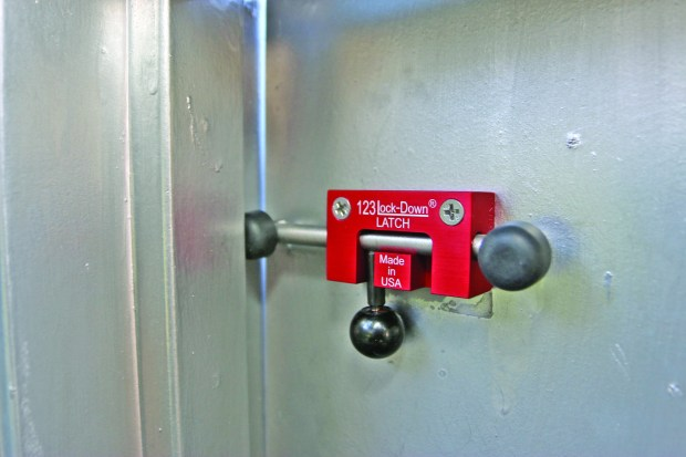 The 123 Lock-Down Latch works by keeping a locked door slightly ajar so students can enter and exit a classroom easily. In the event of a lockdown, anyone inside can slide the latch and close and lock the door. (David Rosenfeld/SCNG)