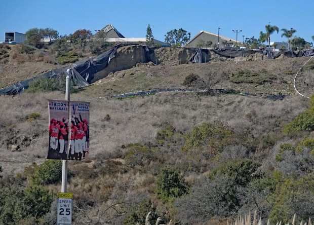 This is the view from Avenida Pico and San Clemente High School of a collapsed slope atop Calle Frontera in the parking lot of St. Andrews Methodist Church, pictured Feb. 26, 2018. (Photo by Fred Swegles, Orange County Register/SCNG)
