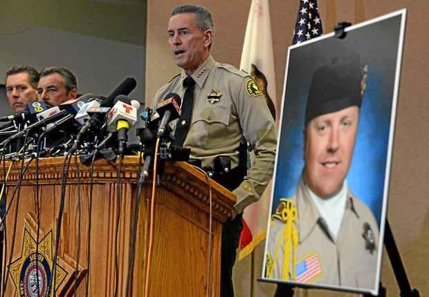 The San Bernardino County Sheriff's Department press conference from Wednesday, February 13, 2013, at the San Bernardino County Sheriff's Headquarters in San Bernardino where the identity of the Detective Jeremiah MacKay was confirmed. Staff file photo.
