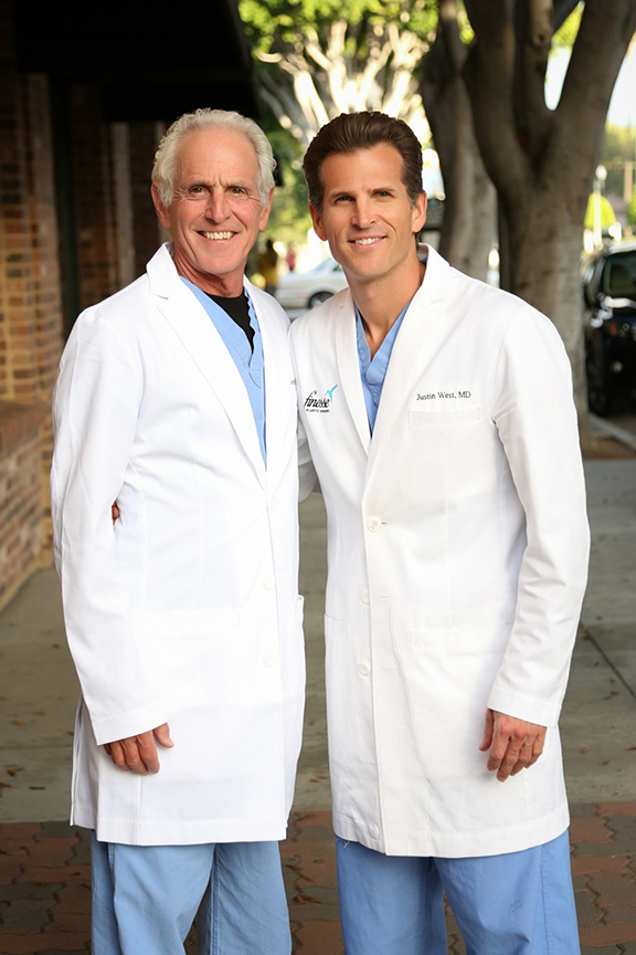 Dr. John West poses with his son, Dr. Justin West