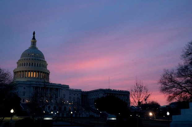The Capitol Dome of the Capitol Building at sunrise, Friday, Feb. 9, 2018, in Washington. After another government shutdown, congress has passed a sweeping long term spending bill which President Donald Trump is expected to sign later this morning. (AP Photo/Andrew Harnik)