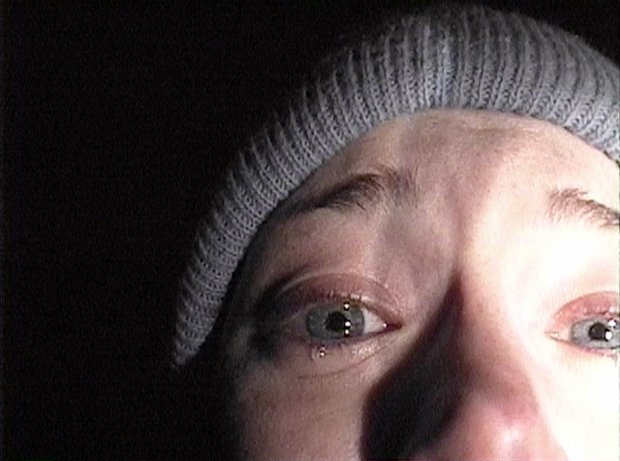 "Heather Donahue turns the camera on herself during her confession scene from the horror film ""The Blair Witch Project."" (AP Photo/Artisan Entertainment)"