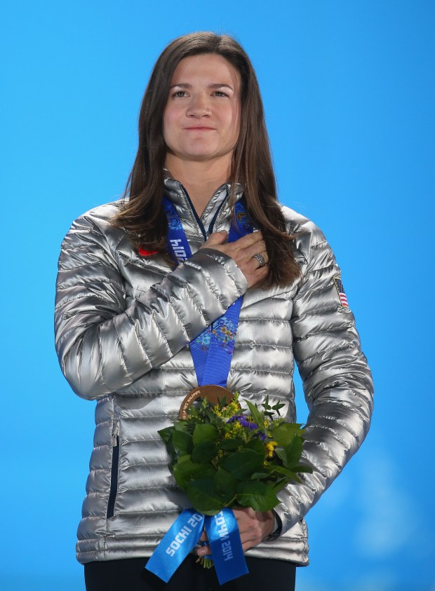 Bronze medalist Kelly Clark celebrates during the medal ceremony for the Snowboard Ladies' Halfpipe on day six of the Sochi 2014 Winter Olympics at Medals Plaza on February 13, 2014 in Sochi, Russia. (Photo by Quinn Rooney/Getty Images)