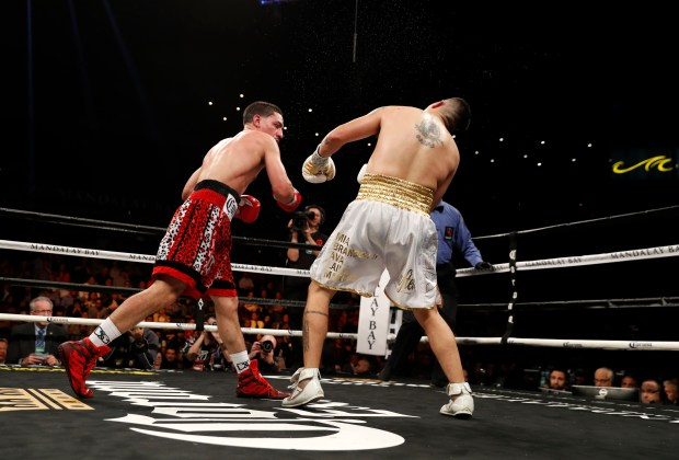 Danny Garcia (L) connects on Brandon Rios and sends him to the canvas during the ninth round of their welterweight boxing match at the Mandalay Bay Events Center on February 17, 2018 in Las Vegas, Nevada. Garcia won the fight with a ninth-round TKO. (Photo by Steve Marcus/Getty Images)