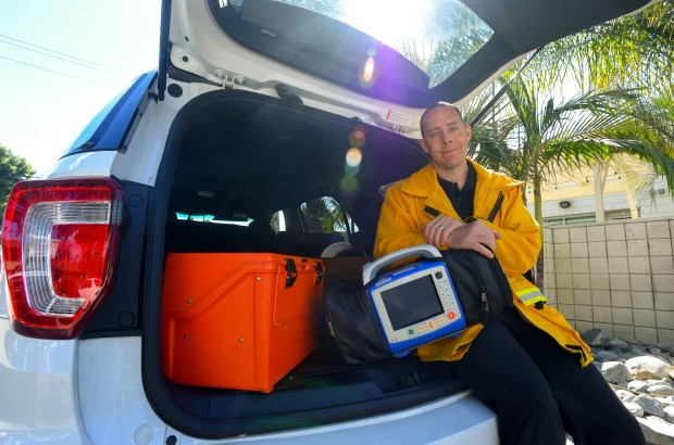 Dr. Clayton Kazan in the trunk of his work SUV, where he keeps a stash of medical supplies. (Photo by Scott Varley, Contributor)