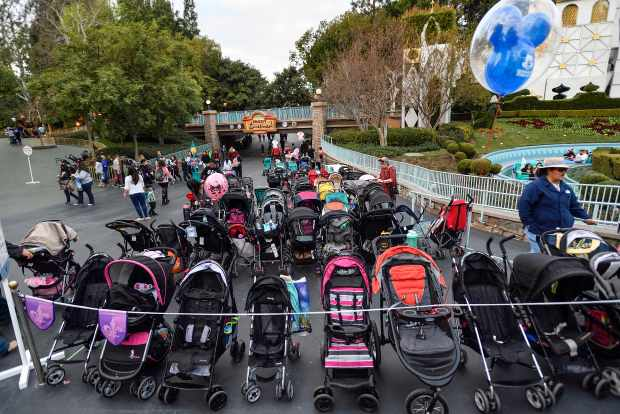 Strollers are lined up in a parking area next to It's a Small World in Fantasyland at Disneyland in Anaheim on Wednesday, Feb 14, 2018. (Photo by Jeff Gritchen, Orange County Register/SCNG)