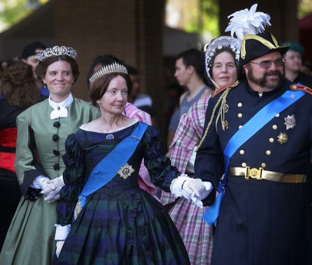 Queen Victoria, portrayed by Janet Clark of Torrence, makes an entrance to Riverside Dickens Festival with an escort from her Prince Consort, portrayed by Tim Clark of Lake Elsinore, on Saturday, Feb. 27, 2016.