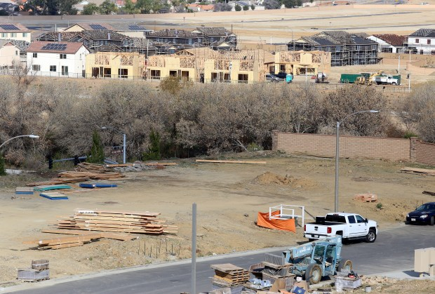 Workers work on some of the new homes near Newport Road and Murphy Ranch Road in Menifee Thursday, Feb. 22. Photo by Frank Bellino, contributing photographer