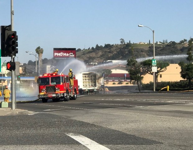 Firefighters pour water on a burning big rig carrying highly flammable hydrogen in Diamond Bar on Sunday, Feb. 11, 2018. (Courtesy, Los Angeles County Fire Department)