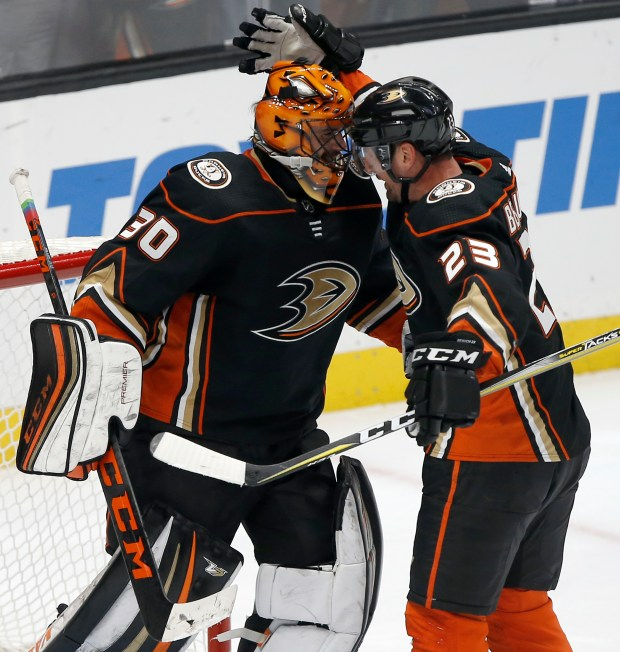 Anaheim Ducks defenseman Francois Beauchemin, right, celebrates with goaltender Ryan Miller, after the Ducks defeat the Dallas Stars in an NHL hockey game in Anaheim, Calif., Wednesday, Feb. 21, 2018. The Ducks won 2-0. (AP Photo/Alex Gallardo)