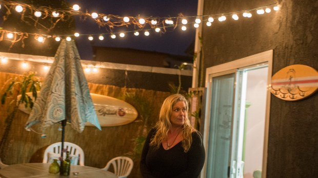 Mary Tautai in her surf themed backyard at her apartment is being forced out of her Torrance home due to rent increase she's a single mom in Torrance Tuesday, February 27, 2018. (Photo by Thomas R. Cordova / Daily Breeze)