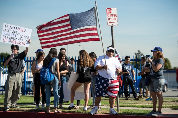 Tom Celiz, of Pico Rivera, protests with his wife Maria, right, against El Rancho teacher Gregory Salcido as students, left, show support for the teacher outside El Rancho High School on Friday, Feb. 2, 2018. Salcido, who was put on administrative leave following an anti-military tirade, is also on the Pico Rivera City Council. (Photo by Sarah Reingewirtz, Pasadena Star-News/SCNG)