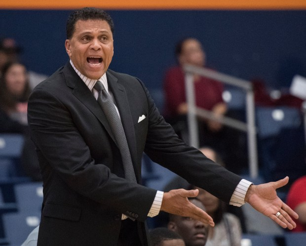 Cal State Northridge head coach Reggie Theus yells instructions to his players during a Big West Conference game at Cal State Fullerton in Fullerton in February. Theus was fired on Wednesday. (Photo by Kyusung Gong/Contributing Photographer)