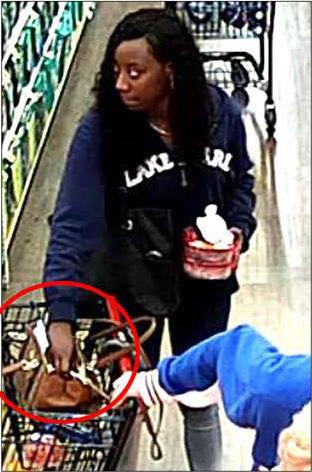 A woman identifed by Riverside County sheriff's detectives as Domonique Porche Richmond, 26, is seen in an image from surveillance video allegedly stealing an 85-year-old woman's wallet on Feb. 20, 2018, at Stater Bros., 29061 Newport Road in Menifee. She was arrested along with an alleged accomplice on March 1. (Image courtesy of the Perris Sheriff's Station)