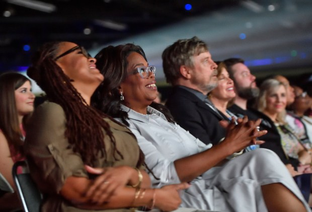 Ava Duvernay enjoys a moment at a Disney promotional event with Oprah Winfrey and Mark Hamill. (Photo: Associated Press)