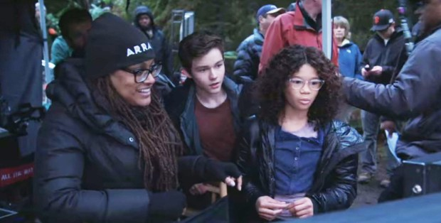 "Ava Duvernay looks at footage with cast members of ""A Wrinkle in Time"" on the film's set in a moment from the Disney featurette on the making of the much-anticipated blockbuster. (Photo: Disney, via YouTube)"