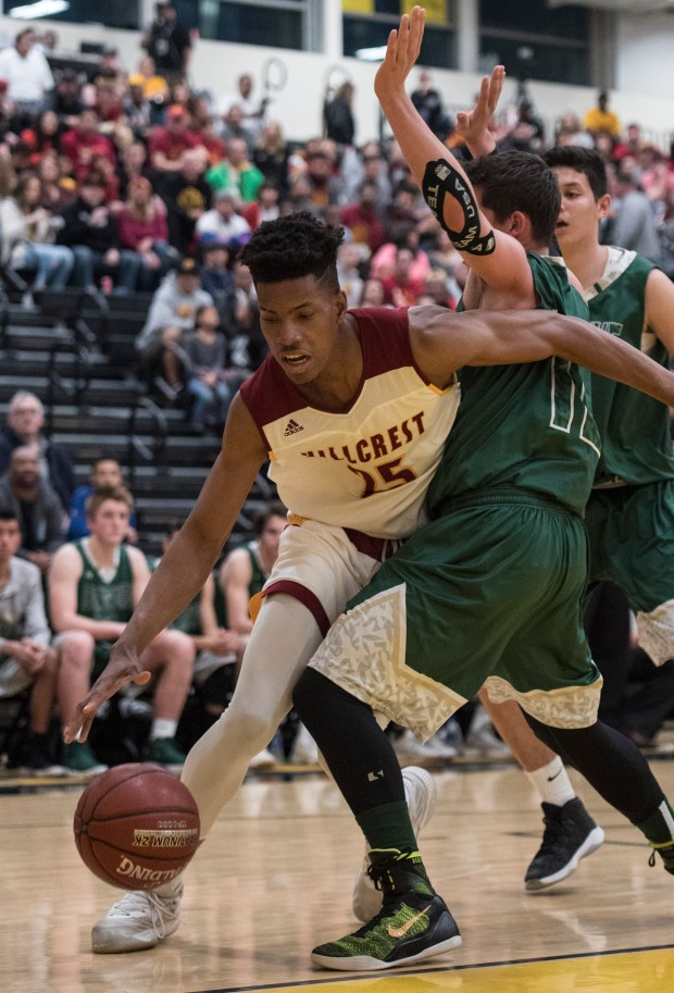 Hillcrest's Victor Ohia Obioha, left, tries to drive towards the basket past St. Bonaventure's Jordan Butler during the CIF-SS Division 4AA championship at Godinez Fundamental High School in Santa Ana on Saturday, March 3, 2018. (Photo by Kyusung Gong/Contributing Photographer)