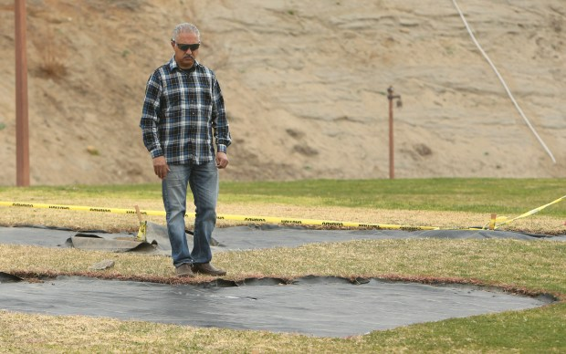 "Arlen Verdehyou, of Norco, stands at the site of a garden that will be planted in the shape of a heart in honor of his late wife, Bennetta Betbadal, at Pikes Peak Park in Norco. Bennetta was killed in the Dec. 2, 2015, terrorist attack in San Bernardino. The garden, to be named ""Bennetta's Heart Healing Grove Memorial,"" will feature a jacaranda tree in Bennetta's honor, 13 redbud trees to represent the other 13 attack victims. (Stan Lim, The Press-Enterprise/SCNG)"