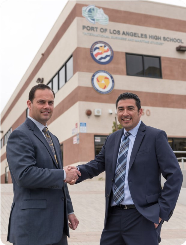 L-R Tom Scotti and  George Mora.  The Port of Los Angeles High School (POLAHS) Board of Trustees unanimously voted at the March 7th meeting to hire current Dean of Students, George Mora, to lead the independent charter school as Principal. Photo Courtesy of  Port of Los Angeles High School