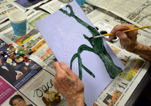 A resident at the Belmont Village of RPV, painting a tree inspired by students, members of the Principal's Advisory Committee (PAC) at Rancho Del Mar Continuation High School in Rolling Hills. The students visit the seniors monthly with a new art project to engage in and spark conversations. Rolling Hills, March 6, 2018. Photo by Brittany Murray, Daily Breeze/SCNG