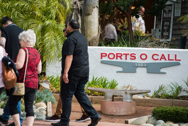 Patrons walk to the Ports O' Call Restuarant in San Pedro Monday, March 12, 2018. A ruling is expected this week on the restaurant's refusal to leave after receiving a March 1 eviction notice from the Port of Los Angeles. (Photo by Thomas R. Cordova / Daily Breeze)