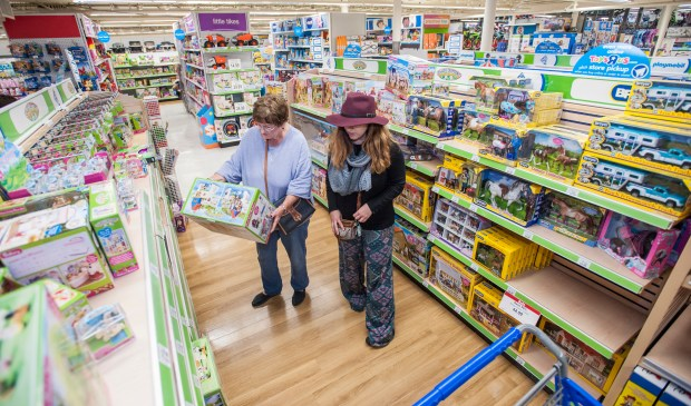 "Helen Nicosia, left, and Anna Miars of Huntington Beach shop at Toys ""R"" Us in Huntington Beach. (MARK RIGHTMIRE, THE ORANGE COUNTY REGISTER)"