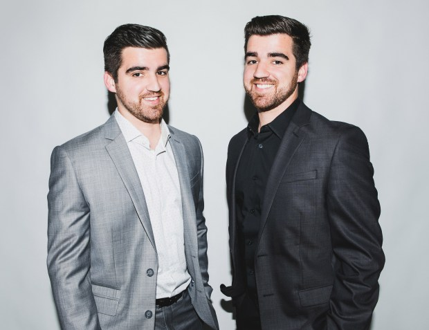 Identical twins Ryan and James Fratzke make videos partly to satisfy their own curiosity and partly as a marketing strategy to promote their consulting business. (Photo by Anna Lee)