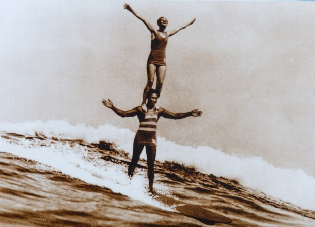 Duke Kahanamoku surfing tandem with Viola Hartman, Corona del Mar, in 1922. (Photo courtesy of Surfing Heritage and Culture Center)