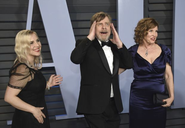 "Chelsea Hamill, from left, Mark Hamill, and Marilou York arrive at the Vanity Fair Oscar Party on Sunday, March 4, 2018, in Beverly Hills. The ""Star Wars"" icon will receive his own star on the Hollywood Walk of Fame during a ceremony Thursday, March 8. (Photo by Evan Agostini/Invision/AP)"