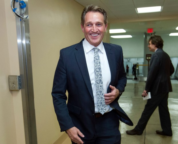 Sen. Jeff Flake, R-Ariz., seen above, said he may stand up against President Trump in 2020, either as a Republican or an independent, if no one else does. (AP Photo/Jose Luis Magana, File)