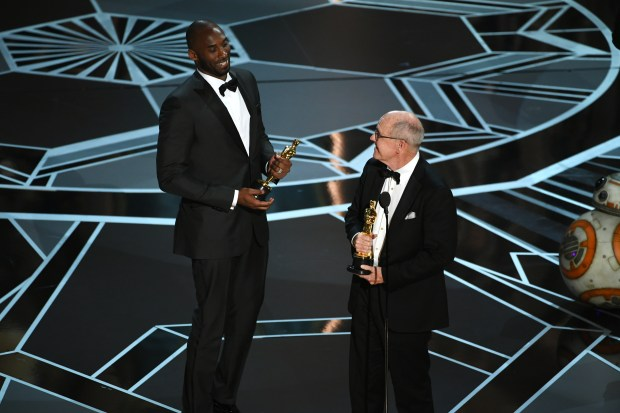 HOLLYWOOD, CA - MARCH 04: Filmmakers Kobe Bryant (L) and Glen Keane accept Best Animated Short Film for 'Dear Basketball' onstage during the 90th Annual Academy Awards at the Dolby Theatre at Hollywood & Highland Center on March 4, 2018 in Hollywood, California. (Photo by Kevin Winter/Getty Images)