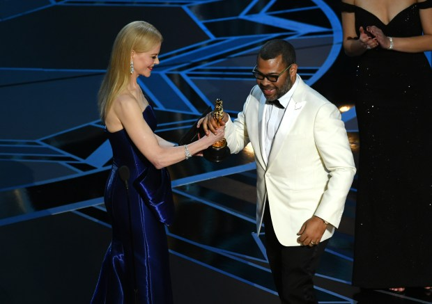 HOLLYWOOD, CA - MARCH 04: Writer/director Jordan Peele (R) accepts Best Original Screenplay for 'Get Out' from actor Nicole Kidman onstage during the 90th Annual Academy Awards at the Dolby Theatre at Hollywood & Highland Center on March 4, 2018 in Hollywood, California. (Photo by Kevin Winter/Getty Images)