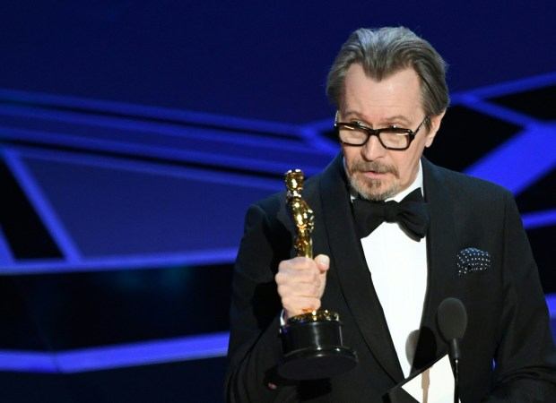 """British actor Gary Oldman delivers a speech after he won the Oscar for Best Actor in """"Darkest Hour"""" during the 90th Annual Academy Awards show on March 4, 2018 in Hollywood, California. / AFP PHOTO / Mark Ralston (Photo credit should read MARK RALSTON/AFP/Getty Images)"""