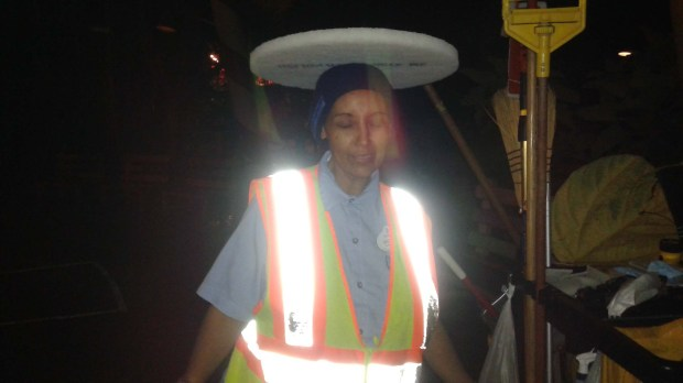 "Yeweinishet ""Weini"" Mesfin, a night janitor at Disneyland Resort, poses for a playful photo during one of her shifts. Mesfin was homeless and living out of her car, a secret she kept from family and coworkers. She died in her car in late 2016. (Photo courtesy of Mindy Martin)"